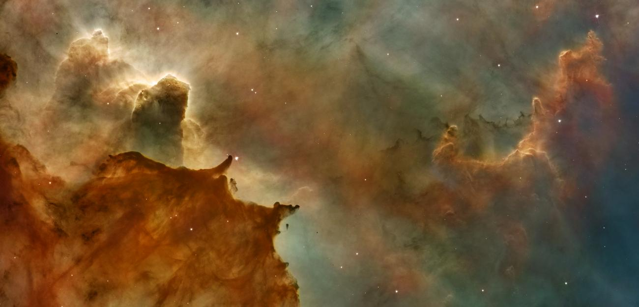 A swirl of colors and gaseous clouds in a nebula