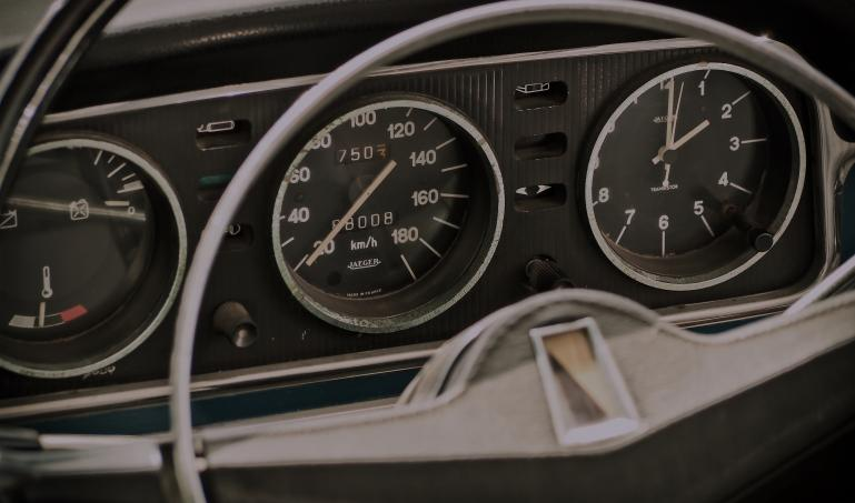 A vintage car dashboard.