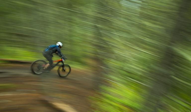 Mountain biker accelerating downhill