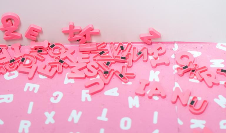 A photo of magnetic letters scattered on a table
