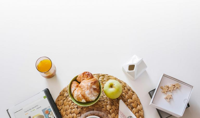 Breakfast table with an iPad displaying the Martha Stewart Living website on screen