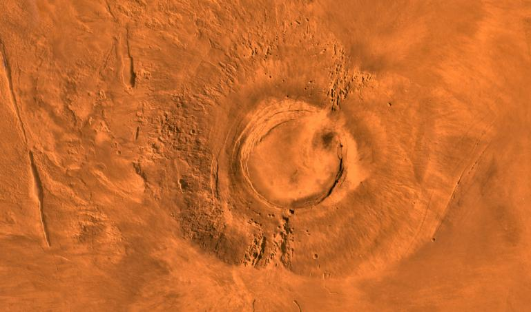 An overhead view of a volcano on Mars
