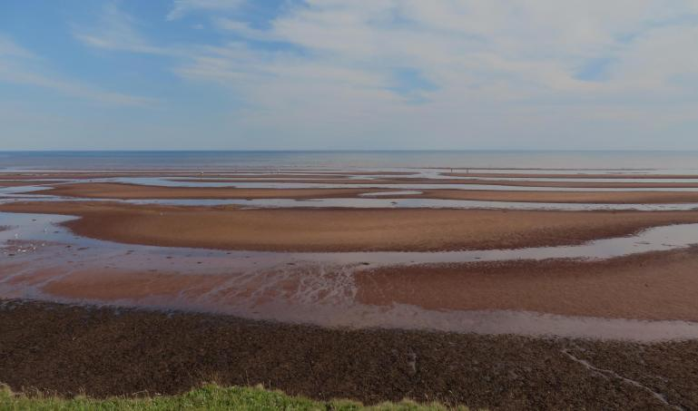 A red sand beach on Prince Edward Island.